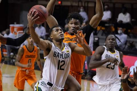 Baylor Oklahoma St Basketball Baylor guard Jared Butler (12) goes to the basket in front of Oklahoma State forward Matthew-Alexander Moncrieffe, rear, in the first half of an NCAA college basketball game Saturday, Jan. 23, 2021, in Stillwater, Okla. (AP Photo/Sue Ogrocki) (Sue Ogrocki