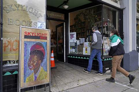Virus Outbreak California Associated Press Shoppers enter the Skylight Book store Monday in the Los Feliz neighborhood of Los Angeles. California has lifted regional stay-at-home orders statewide in response to improving coronavirus conditions. (Damian DovarganesSTF)