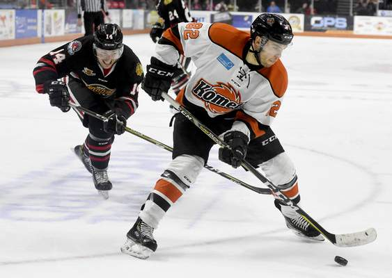 File Anthony Nellis, who has signed with the Komets for a second time, skates toward the Indy Fuel net during a game in 2019.