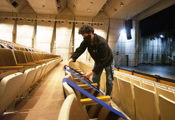 Katie Fyfe   The Journal Gazette Jeremy Springer, Arts United's assistant technical director, blocks off seats in the Arts United Center theater for socially distanced seating. The bands can be moved to reconfigure seating based on the number of tickets bought in a group such as a family.