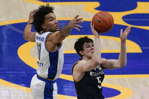 Notre Dame Pittsburgh Basketball Notre Dame's Cormac Ryan (5) shoots as Pittsburgh's Justin Champagnie (11) defends during the first half of an NCAA college basketball game, Saturday, Jan. 30, 2021, in Pittsburgh. (AP Photo/Keith Srakocic) (Keith Srakocic STF)