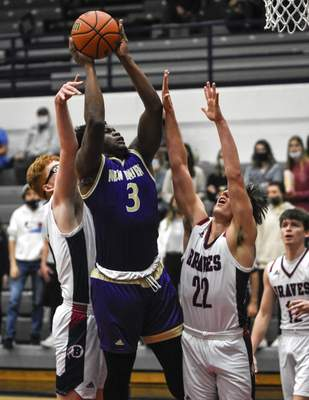 Mike Moore | The Journal Gazette New Haven forward Dre Wright puts up a shot against Bellmont during Tuesday's game at Bellmont.