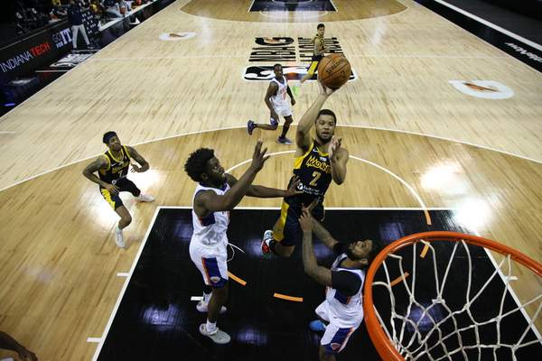 Courtesy Mad Ants/NBAE  Cassius Stanley, middle, goes airborne for a shot in his Mad Ants debut Wednesday in Orlando, Florida.