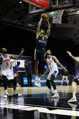 Courtesy Mad Ants/NBAE  Devin Robinson goes up for a dunk in his Mad Ants debut Wednesday in Orlando, Florida.