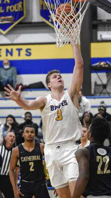 Mike Moore | The Journal Gazette Blackhawk forward Caleb Furst scores a layup on Friday in the second quarter against Cathedral at Blackhawk Christian High School.