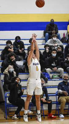 Mike Moore | The Journal Gazette Blackhawk wing Callan Wood shoots the ball in the second quarter against Cathedral at Blackhawk Christian High School on Friday.