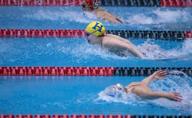 Homestead High School senior Audrey Crowel competes in the Girls 100 Yard Butterfly event during the 47th Annual IHSAA Girls' Swimming and Diving State Finals at IU Natatorium in Indianapolis, Saturday, Feb. 13, 2021.
