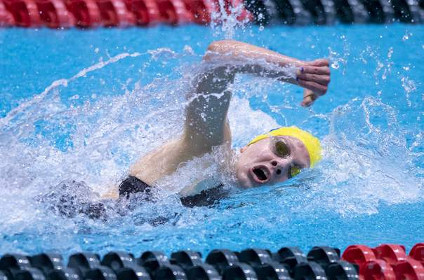 Homestead High School senior Maggie Stock competes in the Girls 100 Yard Freestyle event during the 47th Annual IHSAA Girls' Swimming and Diving State Finals at IU Natatorium in Indianapolis, Saturday, Feb. 13, 2021.