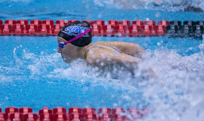 Carroll High School senior Teagen Moon competes in the Girls 100 Yard Butterfly event during the 47th Annual IHSAA Girls' Swimming and Diving State Finals at IU Natatorium in Indianapolis, Saturday, Feb. 13, 2021.