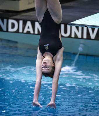 Homestead High School freshman Hannah Brown competes in the diving event during the 47th Annual IHSAA Girls' Swimming and Diving State Finals at IU Natatorium in Indianapolis, Saturday, Feb. 13, 2021. (Doug McSchooler/for Journal-Gazette)