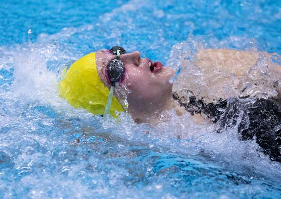 Homestead High School junior Morgan Brown compete in the Girls 100 Yard Backstroke event during the 47th Annual IHSAA Girls' Swimming and Diving State Finals at IU Natatorium in Indianapolis, Saturday, Feb. 13, 2021.