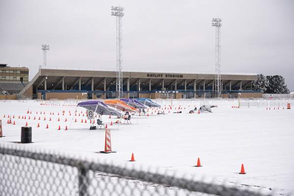 The mass vaccination clinic put on by Medical Center Hospital and the City of Odessa at Ratliff Stadium is seen covered in snow and ice Saturday, Feb. 13, 2021 in Midland, Texas. (Eli Hartman/Odessa American via AP)