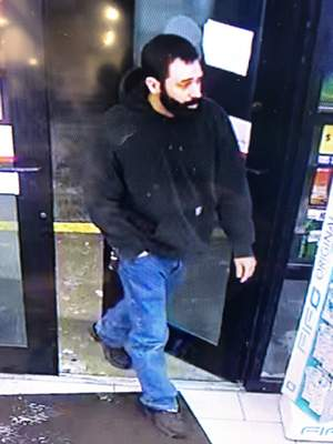 Police are searching for the person in this photo who is considered a suspect in this shooting. He fled the scene in a red pickup truck.