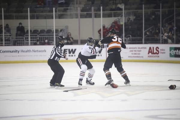 Courtesy Whiteshark Photography Fort Wayne's Morgan Adams-Moisan, right, fights the Indy Fuel's Nic Pierog during Wednesday night's game in Indianapolis.