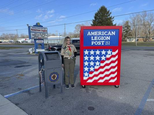 Courtesy photos In order to become an Eagle Scout, Churubusco High School senior Megan Harris, 17, had to complete a community project. She came up with plans to restore the flag retirement box outside American Legion Post 253 in North Webster and build a retirement box where the flags would be stored until a Flag Day ceremony.