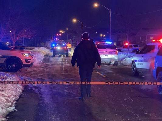 Jamie Duffy | The Journal Gazette  Local police investigate the scene of a triple shooting Wednesday night on Hobson Road near State Boulevard that left two men dead.