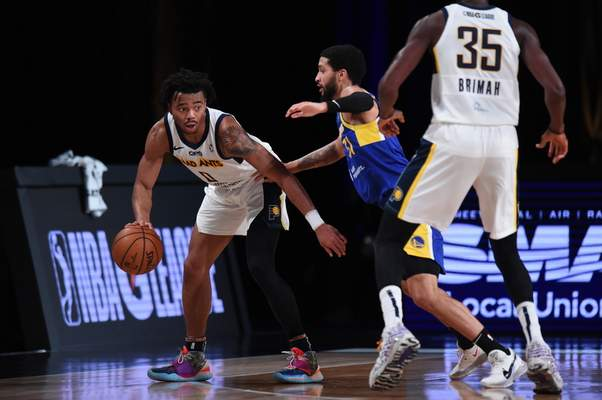 Courtesy Mad Ants/NBAE  Jalen Lecque, left, looks for a play as Mad Ants teammate Amida Brimah prepares to set a pick in Orlando, Florida, on Thursday.