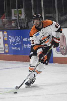 Mike Moore | The Journal Gazette Komets forward Zach Pochiro eyes the net on Friday in the first period against the Wheeling Nailers at Memorial Coliseum.