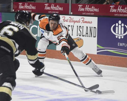 Mike Moore | The Journal Gazette Komets defenseman Randy Gazzola reaches for the puck on Friday in the first period against the Wheeling Nailers at Memorial Coliseum.