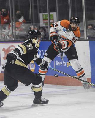 Mike Moore | The Journal Gazette Komets defenseman Mathieu Brodeur takes a shoot at the net in the first period against the Wheeling Nailers at Memorial Coliseum on Friday.