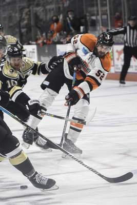 Mike Moore | The Journal Gazette Komets defenseman Mathieu Brodeur shoots his first goal of the season on Friday in the first period against the Wheeling Nailers during the Komets' 69th home opener.