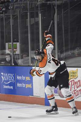 Mike Moore | The Journal Gazette Komets forward Zach Pochiro lines up his shot on Friday in the first period against the Wheeling Nailers at Memorial Coliseum.