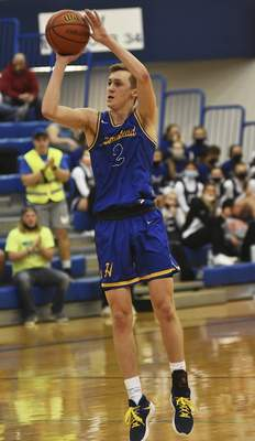 Katie Fyfe | The Journal Gazette  Homestead junior Fletcher Loyer takes a shot during the second quarter against Carroll at Carroll High School on Friday.