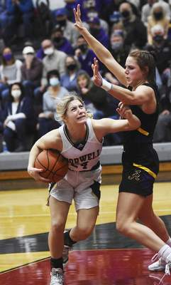 Katie Fyfe | The Journal Gazette  Norwell senior Kaylee Fuelling tries to shoot while Angola senior Hanna Knoll defends her during the second quarter at Bellmont High School Saturday.
