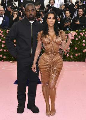 FILE - Kanye West, left, and Kim Kardashian attend The Metropolitan Museum of Art's Costume Institute benefit gala celebrating the opening of the Camp: Notes on Fashion exhibition on May 6, 2019, in New York. Kim Kardashian West filed for divorce Friday, Feb. 19, 2021, from Kanye West after 6 1/2 years of marriage. Sources familiar with the filing but not authorized to speak publicly confirmed that Kardashian filed for divorce in Los Angeles Superior Court. The filing was not immediately available. (Photo by Charles Sykes/Invision/AP, File)
