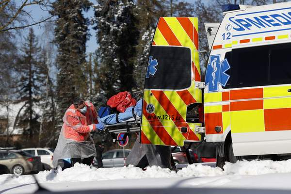 FILE - In this Friday, Feb. 12, 2021, file photo, medical workers move a covid-19 patient into an ambulance at a hospital overrun by the covid pandemic in Cheb, Czech Republic. The Czech government has decided to further tighten restrictive measures amid a surge of a highly contagious coronavirus variant in one of the hardest-hit European Union's nations. At the same time, the worsening situation has forced the Cabinet to abandon for now its plans to reopen all stores as soon as next week. (AP Photo/Petr David Josek/File)