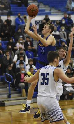 Katie Fyfe | The Journal Gazette Homestead junior Fletcher Loyer puts up a shot in traffic during the first quarter Friday night against Carroll. He finished with 23 points.
