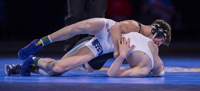 Bellmont High School junior Isaac Ruble wrestles Perry Meridian High School senior Alexzander Cottey in the 113 pound weight class during the 83rd annual IHSAA Wrestling State Finals, Saturday, Feb. 20, 2021, at Bankers Life Fieldhouse. (Doug McSchooler/for Journal-Gazette)