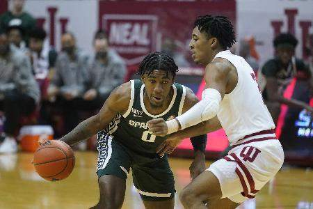 MSU-IU Associated Press: Michigan State's Aaron Henry is defended by Indiana's Armaan Franklin during the first half of an NCAA college basketball game Saturday at Assembly Hall in Bloomington.