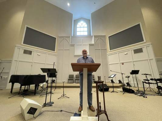 Pastor Jim Conrad stands in the Towne View Baptist Church in Kennesaw, Ga., on Thursday, Feb. 18, 2021. During a Southern Baptist Convention meeting in late February, its executive committee will discuss a recommendation that his church be ousted from the SBC because it accepted LGBTQ people into its congregation. (AP Photo/Angie Wang)