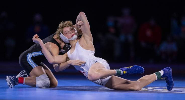 Bellmont junior Isaac Ruble, right, wrestles Perry Meridian's Alexzander Cottey in the 113-pound weight class  Saturday at Bankers Life Fieldhouse in Indianapolis.