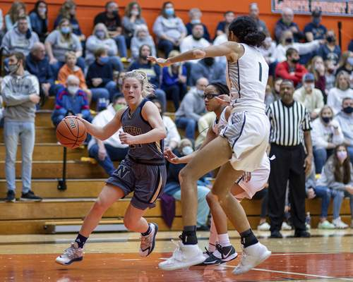 Norwell senior Kaylee Fuelling (24) drives baseline while being double teamed during the Class 3A Semi-State Basketball Tournament at La Porte High School in La Porte, IN