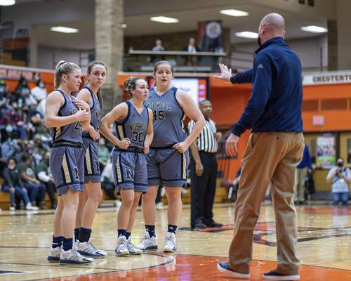 Norwell head coach Eric Thornton has his seniors pause to be recognized by their fans near the end of the Semi-State game at La Porte High School. Norwell fell 40-61 to South Bend Washington. From left to right Kaylee Fuelling (24), Maiah Shelton (22), Laren Bales (30) and Grace Bradtmueller (45).