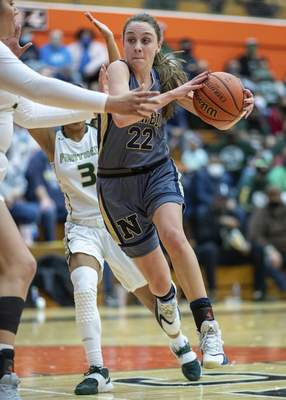 Norwell senior Maiah Shelton (22) drives in the paint during the Class 3A Semi-State matchup at La Porte High School in La Porte, IN.