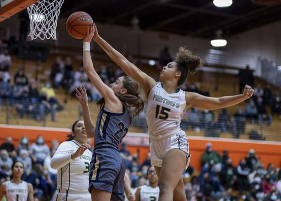 Jeff Douglas | For the Journal Gazette Norwell's Maiah Shelton, left, gets her shot blocked from behind by Mila Reynolds on Sturday at La Porte High School in LaPorte.