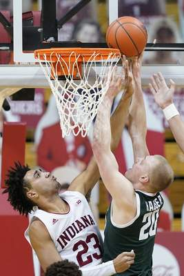 Associated Press Joey Hauser, right, puts up a shot against Indiana's Trayce Jackson-Davis on Saturday in Bloomington.
