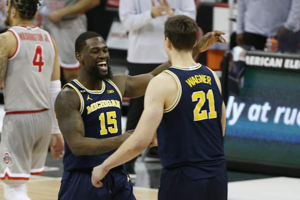 Associated Press Michigan's Chaundee Brown Jr. and Franz Wagner celebrate the No. 3-ranked Wolverines' victory Sunday over No. 4 Ohio State.