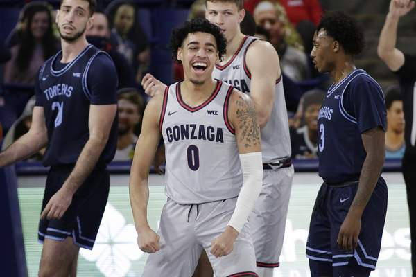 Gonzaga guard Julian Strawther celebrates his basket during the second half of an NCAA college basketball game against San Diego in Spokane, Wash., Saturday, Feb. 20, 2021. (AP Photo/Young Kwak)