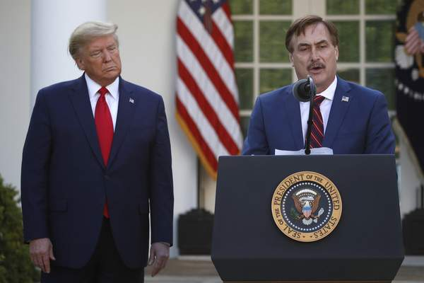 FILE - In this March 30, 2020, file photo, My Pillow CEO Mike Lindell speaks as President Donald Trump listens during a briefing about the coronavirus in the Rose Garden of the White House, in Washington. (AP Photo/Alex Brandon, File)