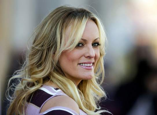 FILE - In this Oct. 11, 2018, file photo, adult film actress Stormy Daniels attends the opening of the adult entertainment fair Venus, in Berlin. (AP Photo/Markus Schreiber, File)