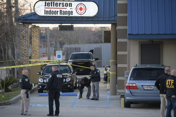 Jefferson Parish Sheriff's Office and Bureau of Alcohol, Tobacco, Firearms and Explosives: ATF investigators look at evidence at the scene of a multiple fatality shooting at the Jefferson Gun Outlet in Metairie, La. Saturday, Feb. 20, 2021. (AP Photo/Matthew Hinton)