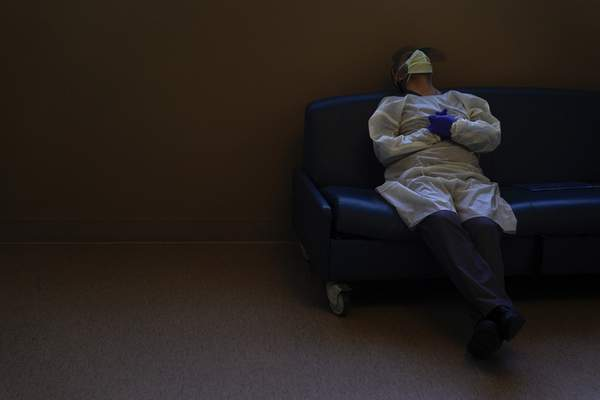 Dr. Mher Onanyan takes a short break while waiting for an X-ray of a COVID-19 patient's lungs at Providence Holy Cross Medical Center in the Mission Hills section of Los Angeles, Tuesday, Dec. 22, 2020. (AP Photo/Jae C. Hong)