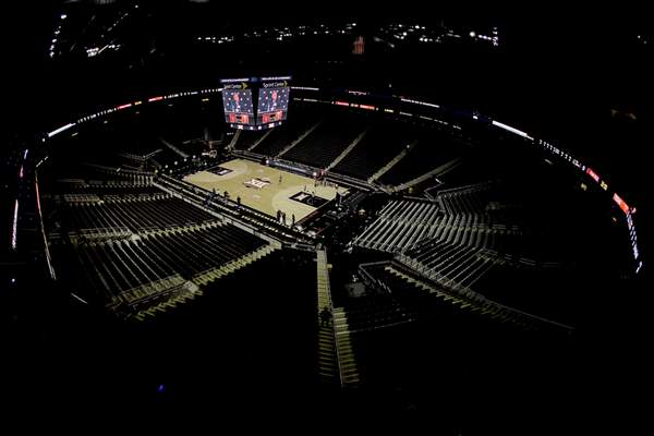 Big 12 commissioner Bob Bowlsby speaks on the scoreboard screen in an empty Sprint Center after canceling the remaining NCAA college basketball games in the Big 12 Conference tournament due to concerns about the coronavirus on March 12, 2020, in Kansas City, Mo. (AP Photo/Charlie Riedel)
