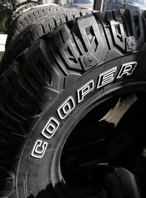 FILE - In this May 2, 2007 file photo, Cooper tires are on display at Vermont Tire and Service Inc. in Montpelier, Vt. Goodyear Tire and Rubber Co. is acquiring Cooper tires in a deal valued at $2.5 billion that will combine the two century-old Ohio companies. (AP Photo/Toby Talbot, File)