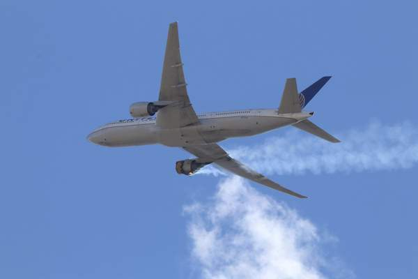 This Saturday, Feb. 20, 2021 photo provided by Hayden Smith shows United Airlines Flight 328 approaching Denver International Airport, after experiencing a right-engine failure shortly after takeoff from Denver. (Hayden Smith via AP)