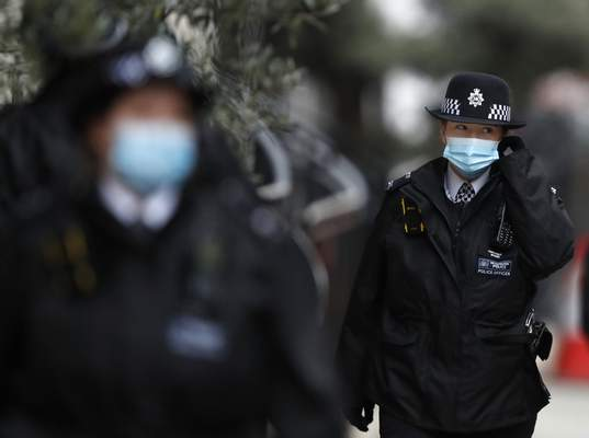 Police stand guard outside the King Edward VII hospital In London, Monday, Feb. 22, 2021, where Britain's Prince Philip is being treated. (AP Photo/Alastair Grant)